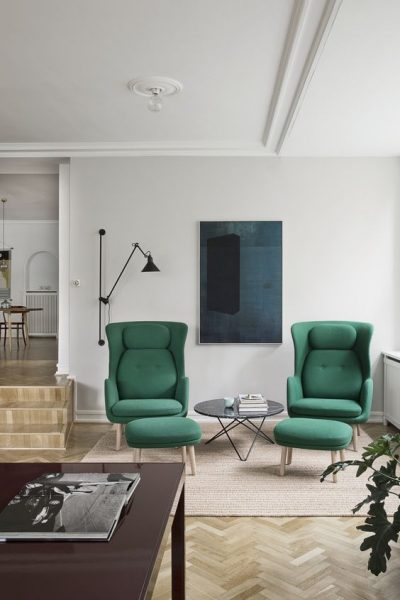 living room with green chairs