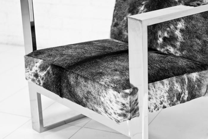 black and white cowhide chair restoration hardware rolling dining chairs www roomservicestore com fat u leg