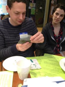 Core team member Gavin O'Brien inspects dirt derived from household compost