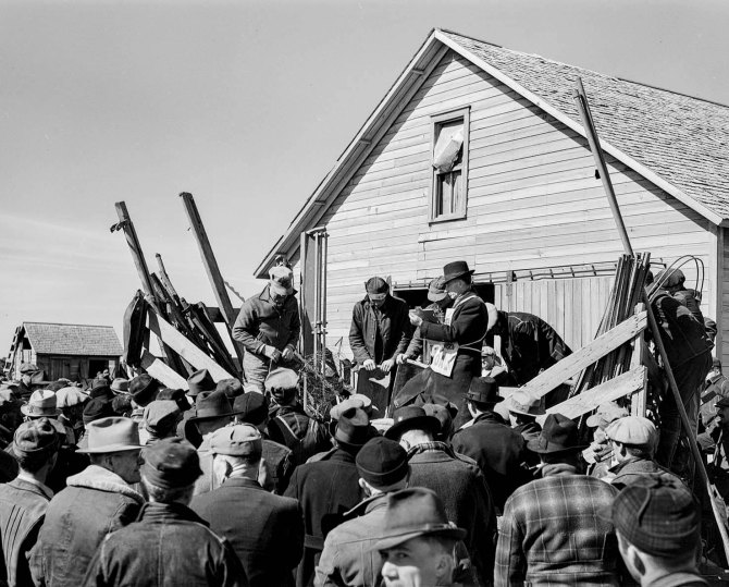 Auctioning farm equipment at Zimmerman farm near Hastings, Nebraska. 1940.