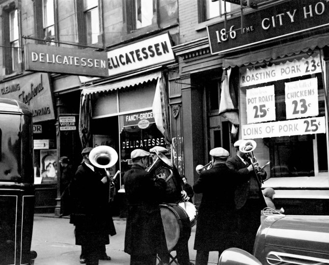 Unemployed street band on sidewalk, Eighth Ave between W 19th & 20th Sts 1937.
