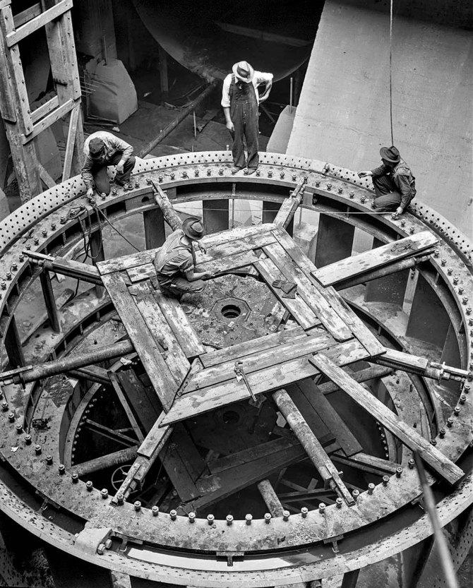 Installation of 30,000 kilowatt generator at the Cherokee Dam of the Tennessee Valley Authority,Tennessee. 1942.