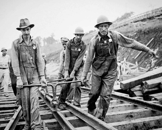 Previously unemployed farmers laying track at Tennessee Valley Authority Douglas Dam project,Tennessee. 1942.