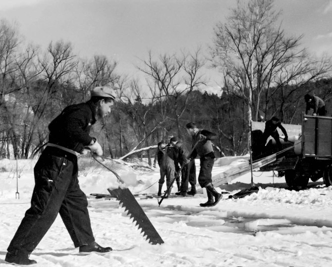 Cutting ice on the Ottaquetchee River. Coos County, New Hampshire. 1936.