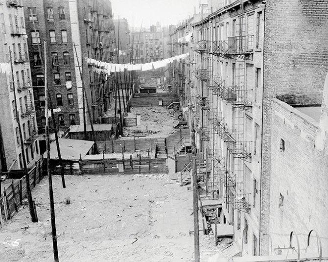 Rear yards of demolished East 3rd Street tenements. 1934. (NYCHA)