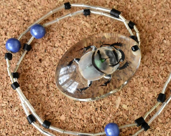 metallic silver beetle necklace