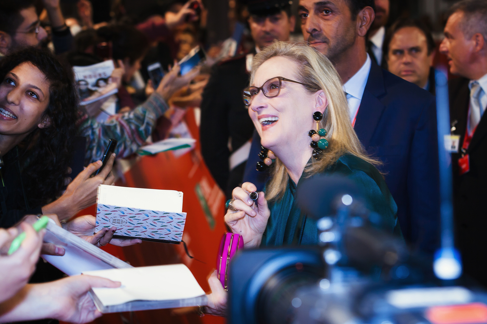 Meryl Streep signing autographs in a crowd