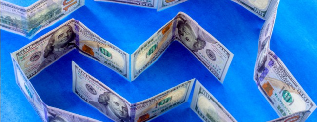 A maze made out of U.S. $100 bills on a blue background.
