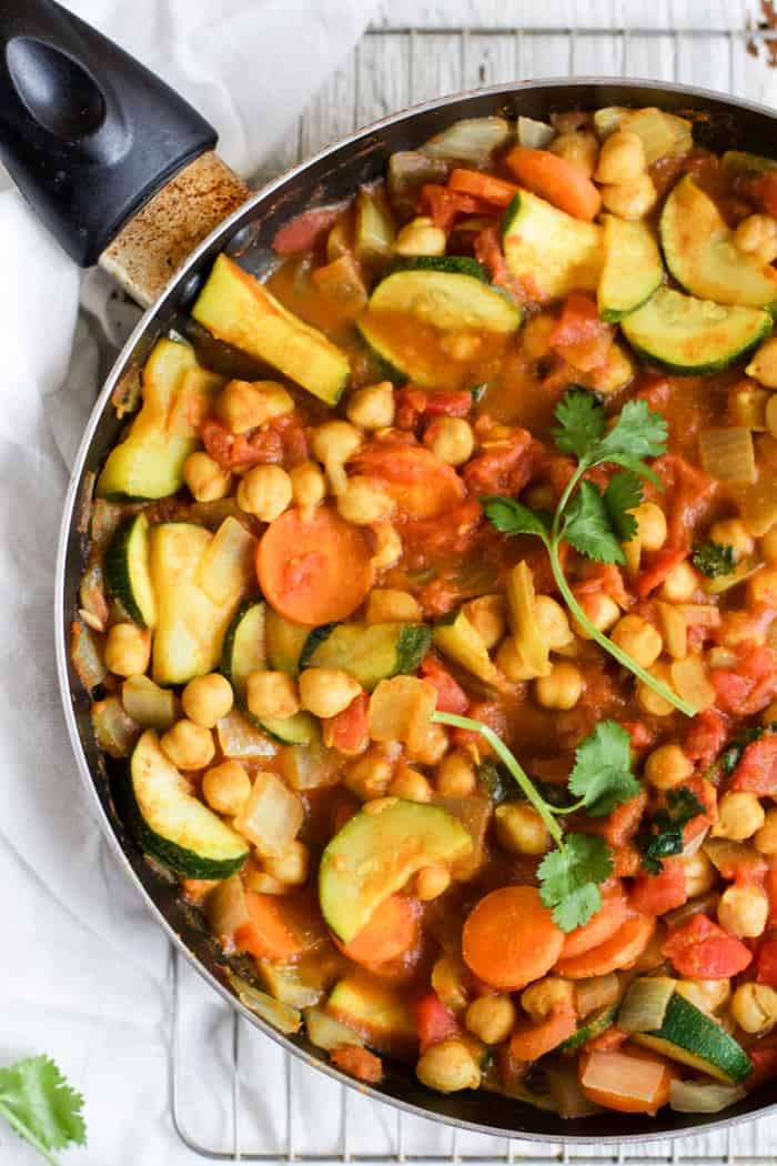 Moroccan Chickpea Veggie Sauté - So much flavor and perfect for a quick and easy weeknight dinner! You've got your standard Moroccan spices, plus tomatoes, chickpeas, carrots and zucchini. Vegetarian and full of exotic flavor. Come and try it out! | rootsandradishes.com