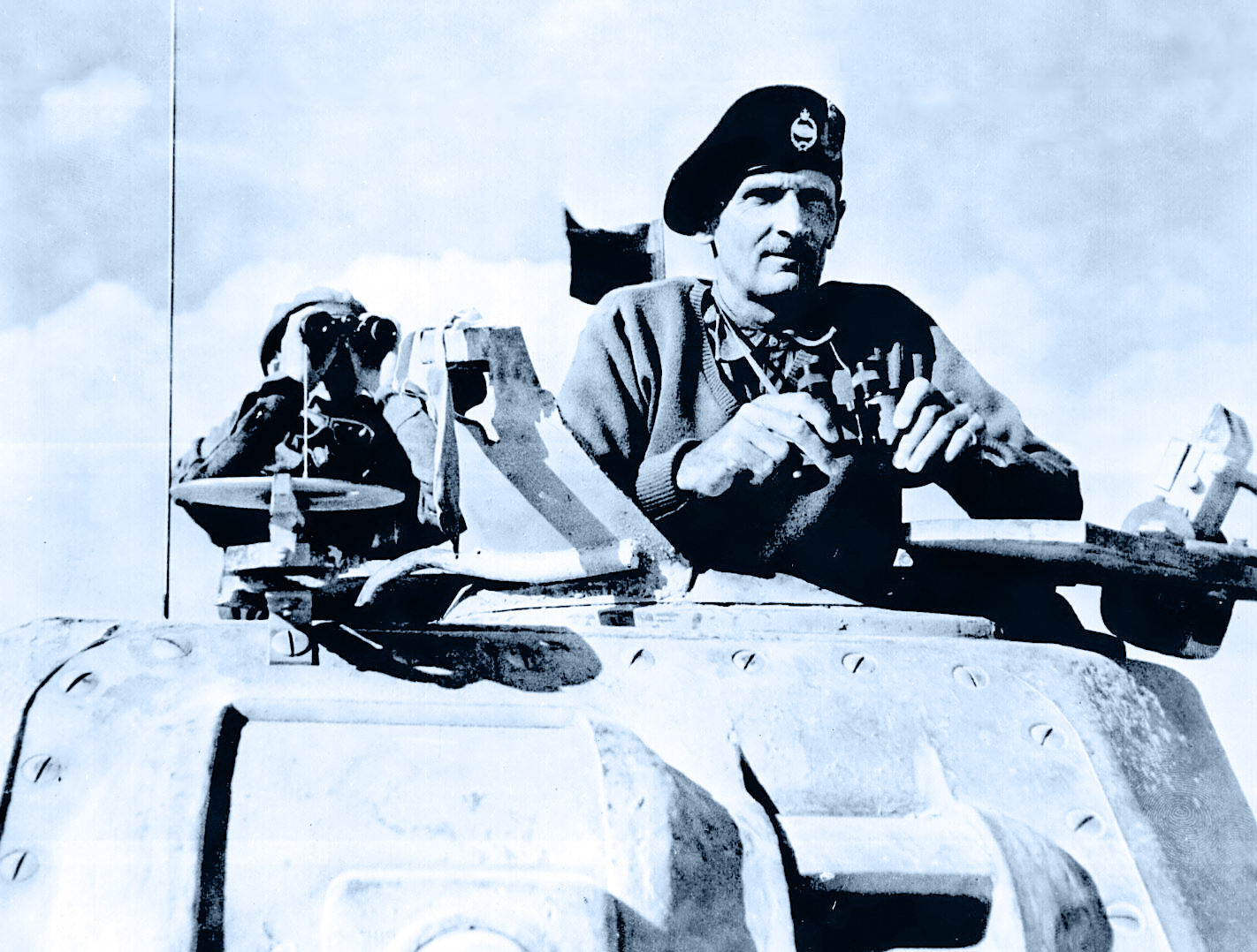 General Bernard L. Montgomery watches his tanks move up. North Africa, November 1942