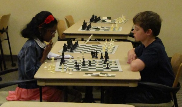 Two 6th grade kids play chess