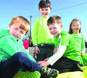 Looking forward to seeing you! Pictured at Scoil Bhríde (Fourmilehouse) recently were pupils Evan, Nathaniel, Jacob and Sophie. Thousands more pupils will return to Roscommon schools from Monday next. Picture: Mick McCormack