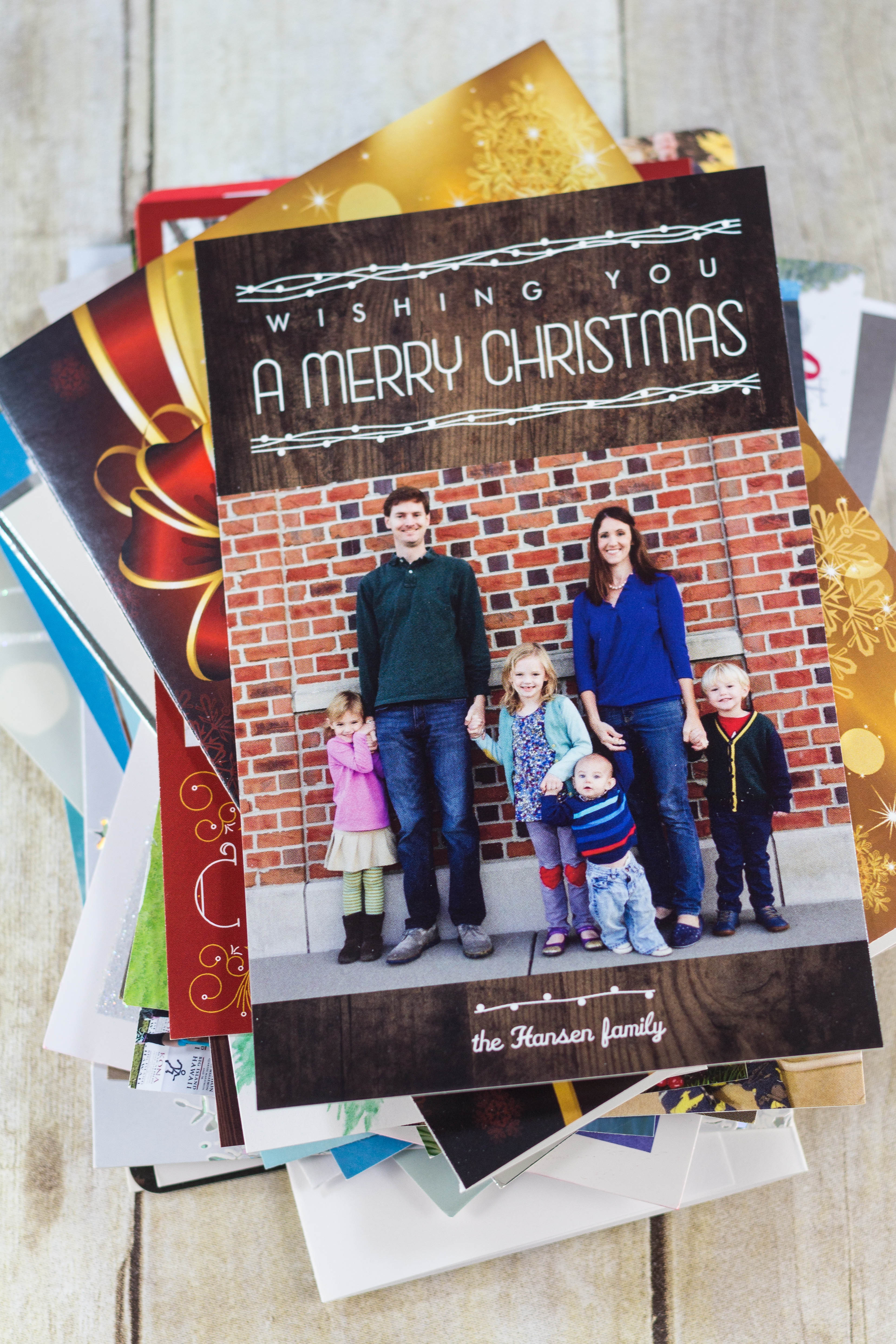 DIY Upcycled Christmas Card Books - Christmas cards, letters, and photos ready for the book.   https://www.roseclearfield.com
