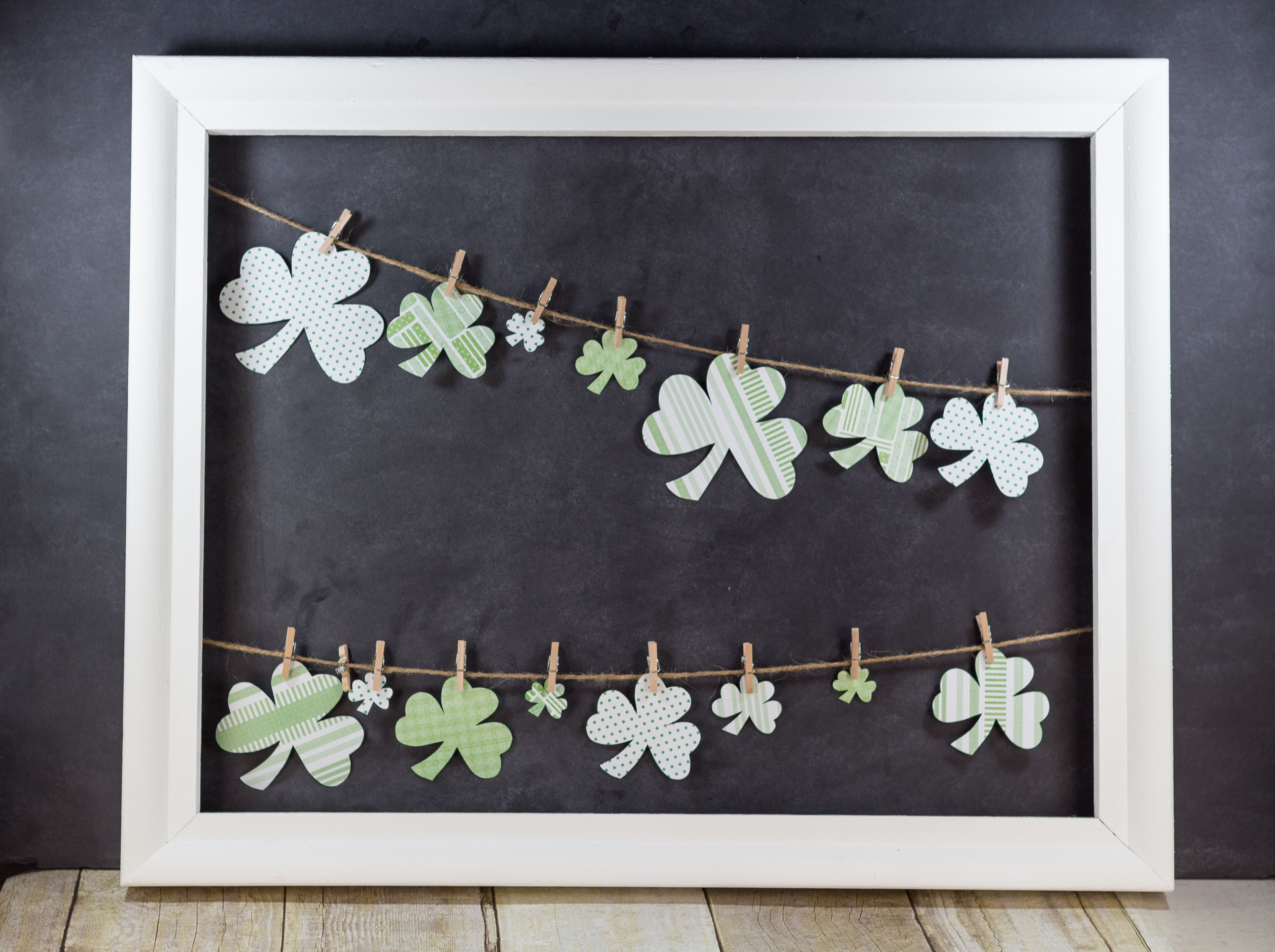 DIY St. Patrick's Day Shamrocks Hanging in Open White Frame   http://www.roseclearfield.com