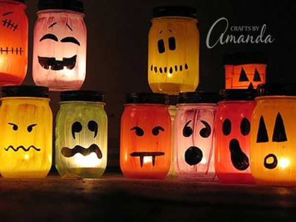 DIY Halloween Mason Jar Decor - Halloween Painted Luminaries via Crafts By Amanda | https://www.roseclearfield.com