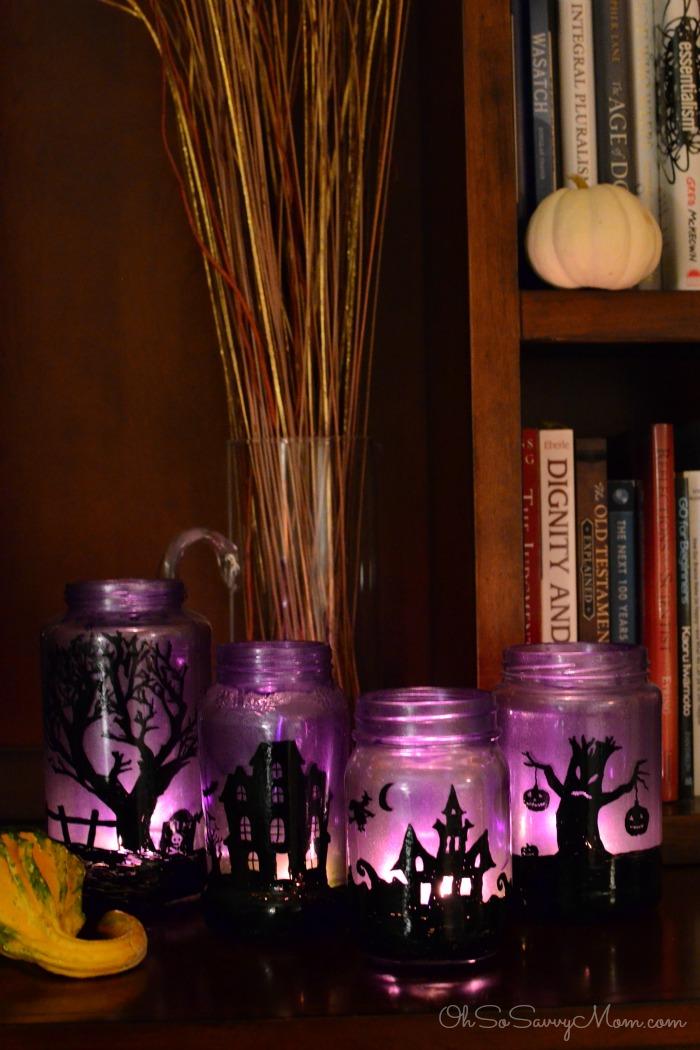 DIY Halloween Mason Jar Decor - Halloween Village Mason Jar Luminaries via Oh So Savvy Mom | http://www.roseclearfield.com