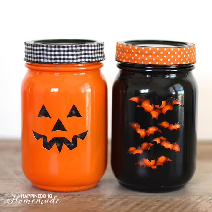 DIY Halloween Mason Jar Decor - Stenciled Halloween Mason Jars via Happiness is Homemade | http://www.roseclearfield.com