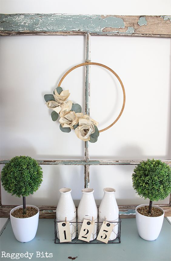 Spring embroidery hoop wreath decor: a farmhouse-style wreath with book page flowers. Perfect for spring decorating! #spring #farmhousestyle #DIYwreath | https://www.roseclearfield.com