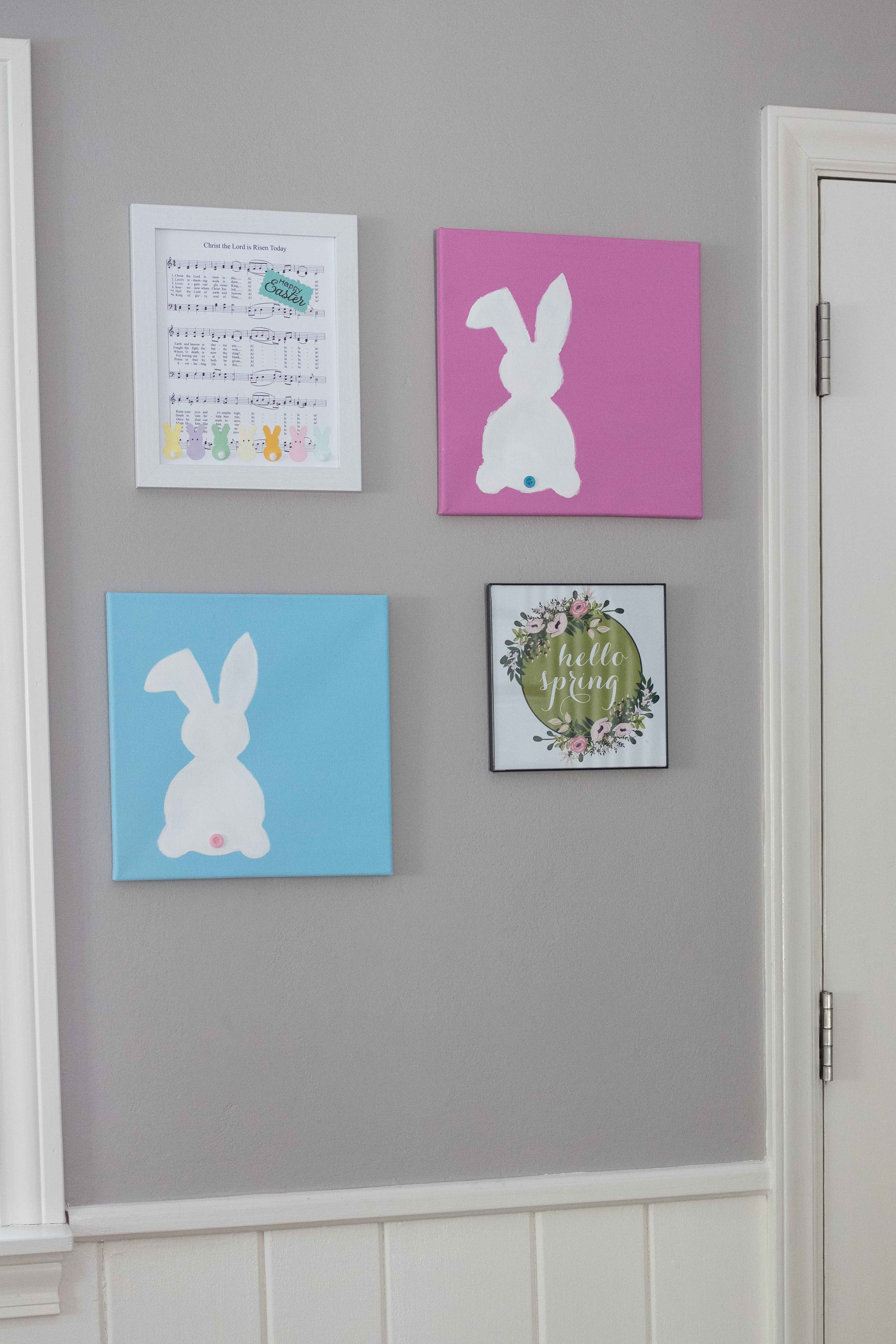 A cheery spring entryway display with DIY Easter sheet music wall decor, DIY bunny canvases, and a free spring printable! #spring #wallart #seasonaldecor | https://www.roseclearfield.com