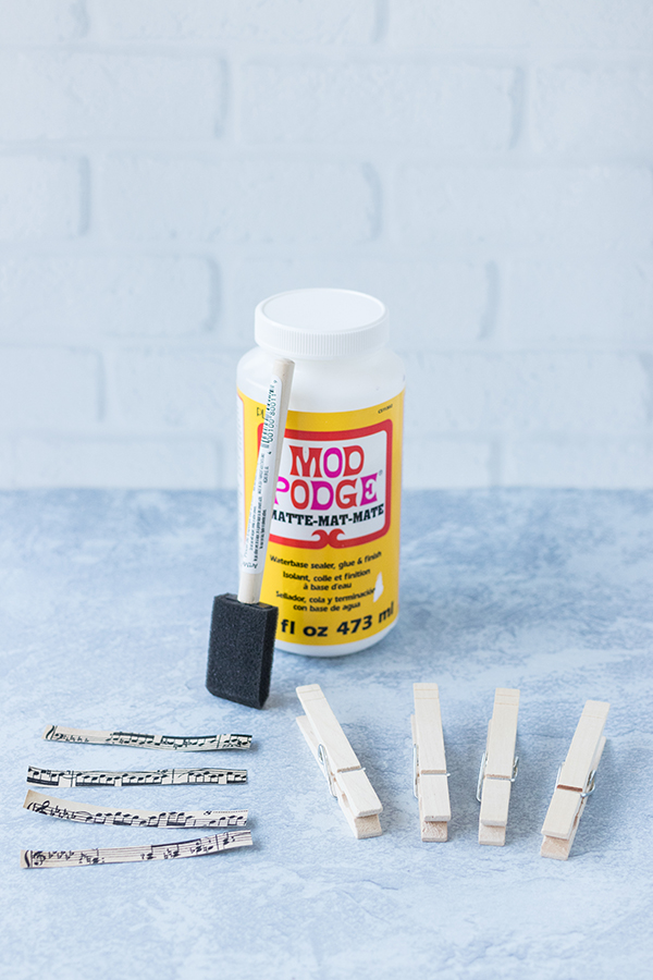 Supplies for DIY sheet music clothespin magnets. #DIY #sheetmusic #ModPodgecraft | https://www.roseclearfield.com