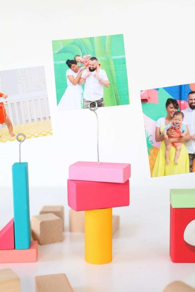 DIY wood block photo holders via Damask Love. So fun and colorful! #DIY #photoholders #popofcolor | https://www.roseclearfield.com