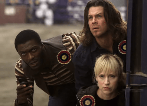 Hardison, Parker, and Eliot, all wearing tricolor cockades