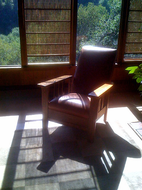 Ethics photo of chair in library with light shining on head area