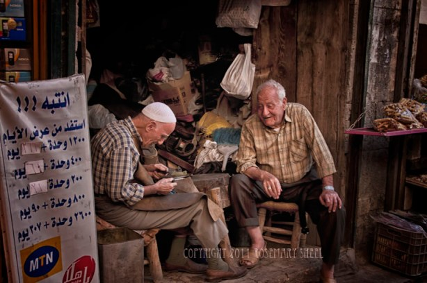 Two friends chat in the Aleppo souk