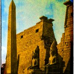 entrance to Luxor Temple in Luxor Egypt with obelisk and seated statures of Ramses