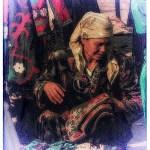 Uzbek woman examines needlework