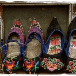 Embroidered shoes for sale in a Chinese village