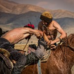 Kazakh men compete in games of strength and horsemanship