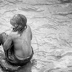 Ethiopia: woman bathing in a stream
