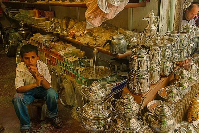 bored boy works as salesman in Mardin Turkey
