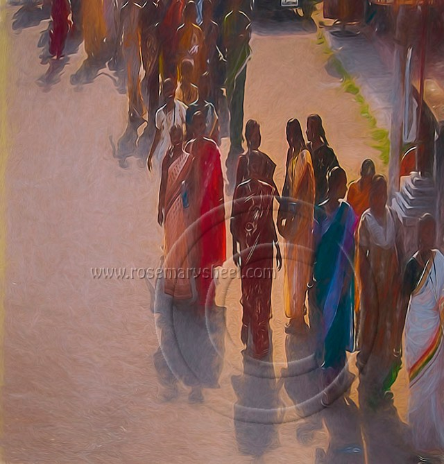 young women wearing saris wander through the town of Kochi