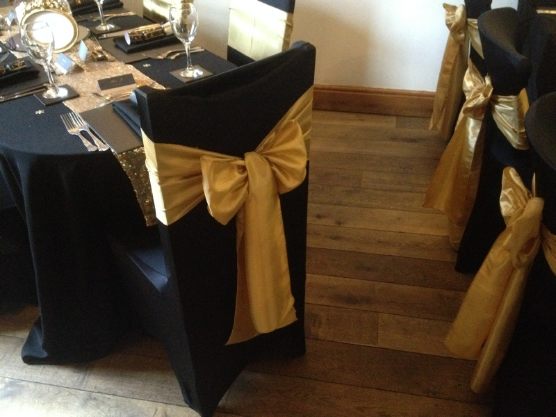 gold chair covers with black sash luxury office chairs wedding event hoods bows lace sashes to hire taffeta on cover carlisle cumbria lake