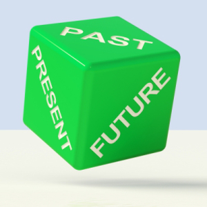 Green die with past, present, and future on faces