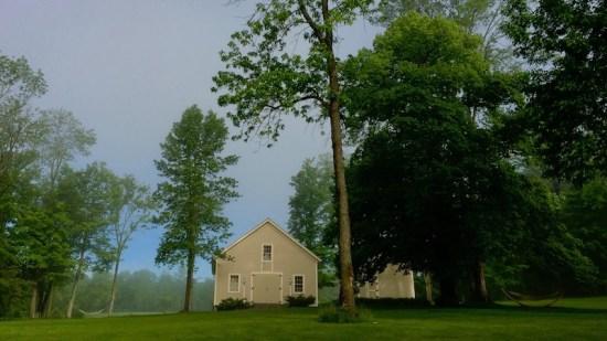 Spring Soggies: first hint of sunshine on Rosslyn's carriage barn after rain, rain, rain... (Source: Geo Davis)