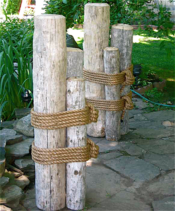 "set two 48"" high wood marine pilings"