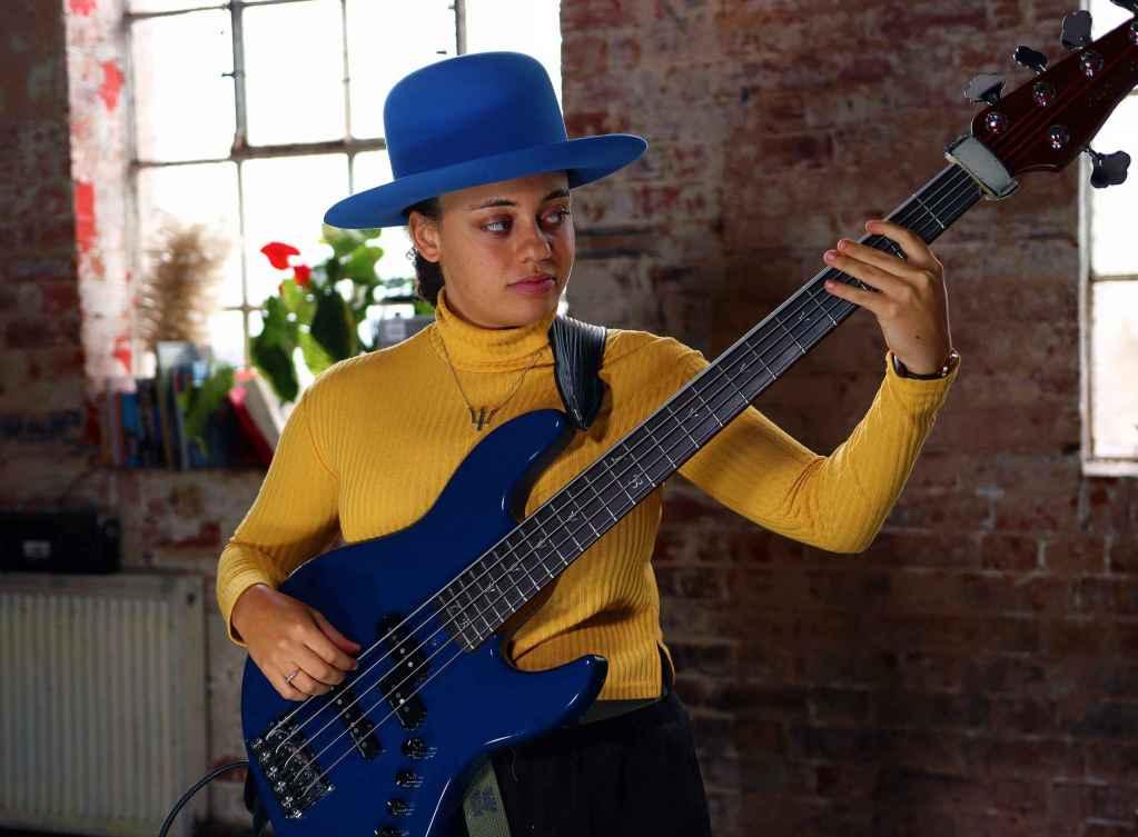 Isobella Burnham Rotosound bassist female bass player with blue Sire