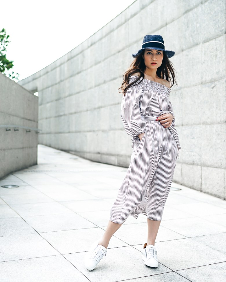 RubyK in Caroline Constas Off-The-Shoulder Striped Cotton Jumpsuit and GIUSEPPE ZANOTTI May London Leather Sneakers