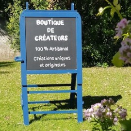 Réalisation d'un panneau signalétique pour la boutique de créateurs : l'art en bulle à Canet plage