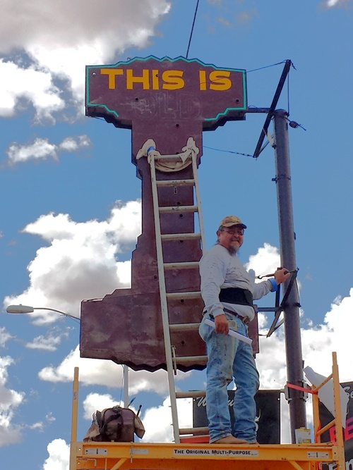 Winslow sign worker