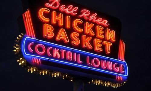 Restored Dell Rhea's Chicken Basket neon sign is dedicated