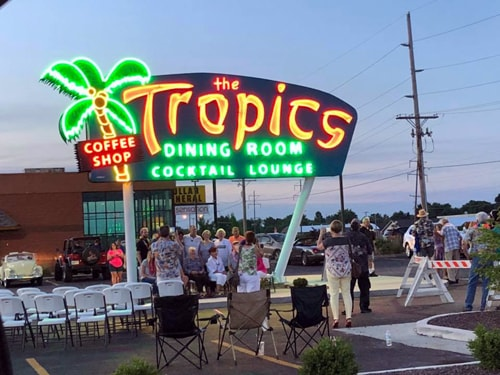 The Tropics sign relighted for the first time in 15 years