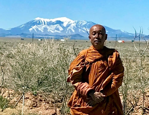 Buddhist monk walking much of Route 66