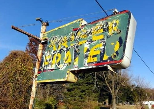 Kaiser-Frazer neon sign near Mitchell disappears