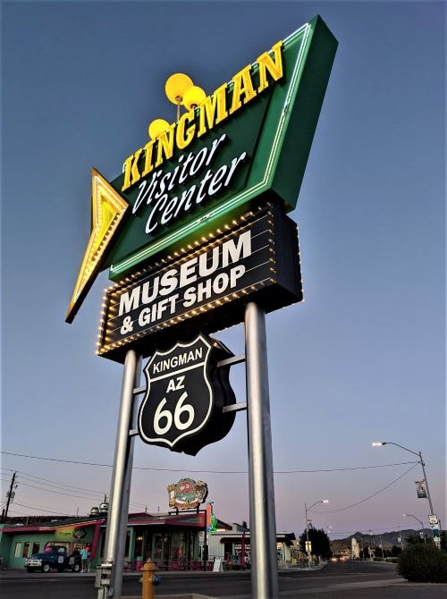 Kingman Visitor Center lights its new but retro-looking neon sign