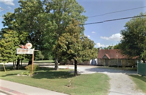 Long-closed Elm's Court property in Tulsa is torn down; sign may be repurposed