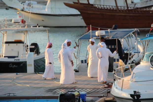 Arab men showing their yachts, Abu Dhabi
